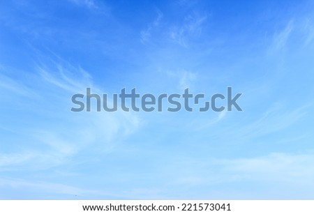 Abstract white clouds and blue sky background. - stock photo