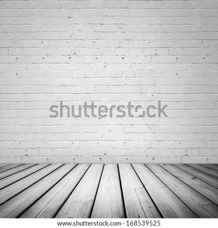 Abstract white interior with wooden floor and brick wall