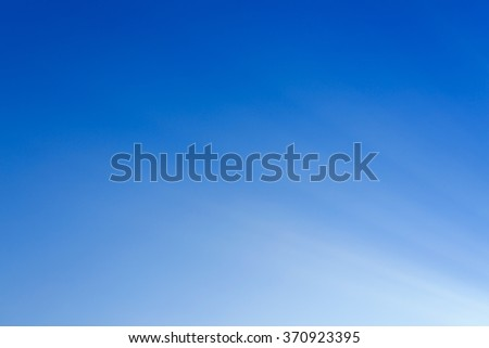 abstract white light on blue background, beam of sunlight on clear blue sky - stock photo