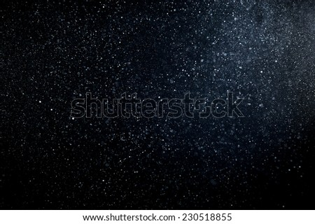 abstract white powder explosion  on black background - stock photo
