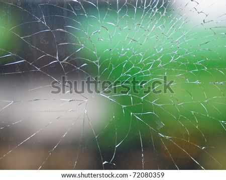 abstract window broken glass with colorful background blur - stock photo
