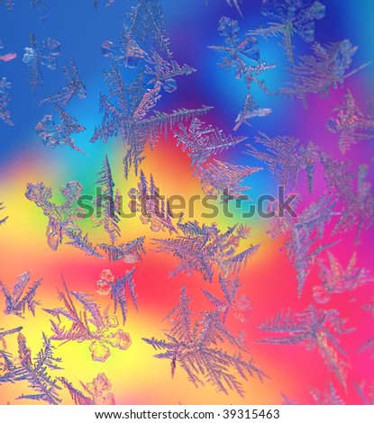 Abstract window frost with colored background - stock photo