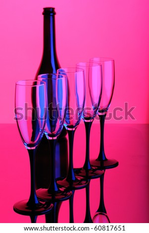 abstract wine bottle and glass pink blue color