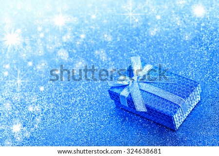 Abstract winter blue christmas background with gift box - stock photo