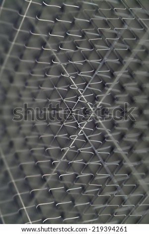 abstract wire cross with dark frame background - stock photo