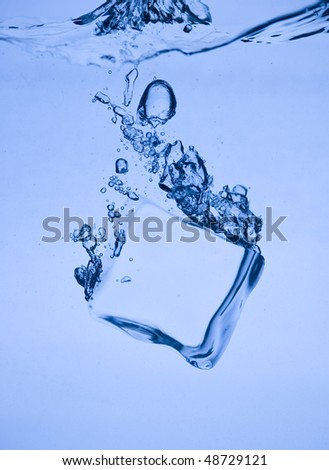 Abstract with blue ice. Creative splashing water and ice