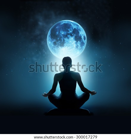 Abstract woman are meditating at blue full moon with star in dark night sky background, Moon original image from NASA.gov   - stock photo