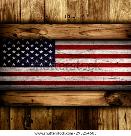 Abstract wooden background with a grunge USA flag. - stock photo