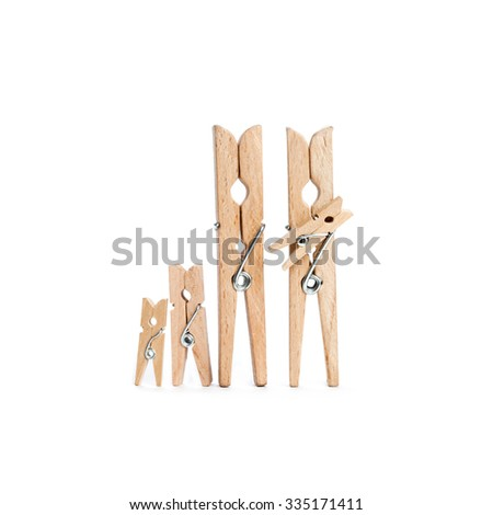 Abstract wooden textured clothespin family: father, mother with kids. white background