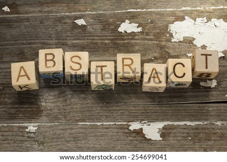 abstract word on toy blocks on a wooden background - stock photo