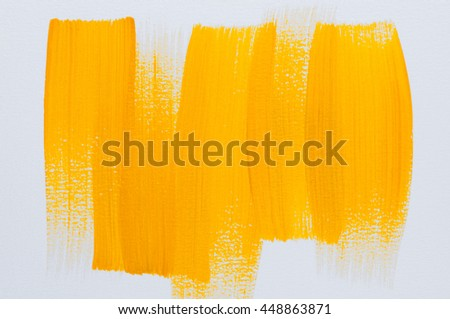 Abstract  yellow Acrylic color hand paint on white background.