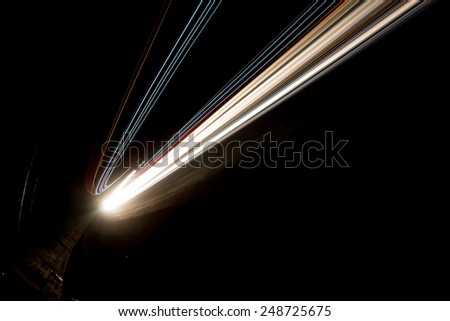 Abstract yellow and white rays of light in a car tunnel - stock photo