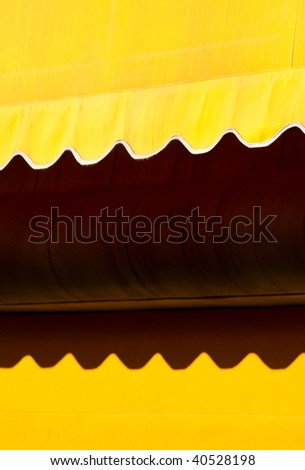 Abstract Yellow Awning - stock photo