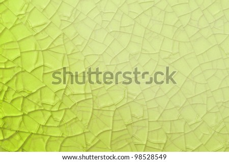 Abstract yellow background with cracks - stock photo