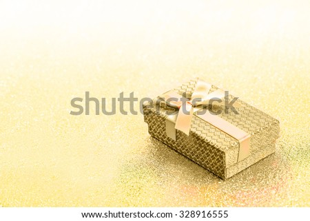 Abstract yellow golden christmas background with gift box - stock photo