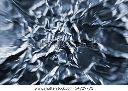 Abstract zoom tunnel of crumpled silver aluminum foil closeup background texture, in blue - stock photo