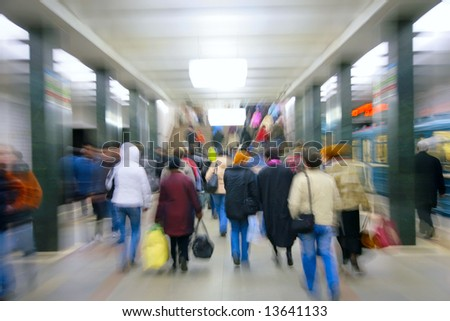 abstract zooming passengers in metro - stock photo