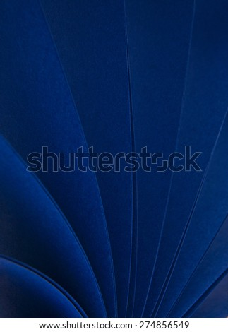 abstraction from the blue paper as a background - stock photo