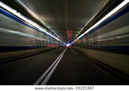 abstractly traveling through a tunnel with motion blur