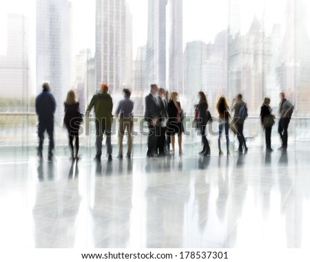abstrakt image of people in the lobby of a modern business center with a blurred background - stock photo
