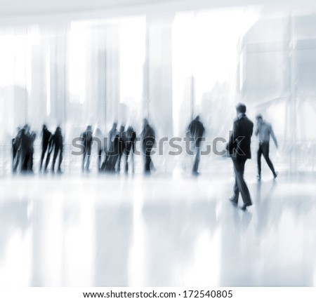 abstrakt image of people in the lobby of a modern business center with a blurred background and blue tonality - stock photo