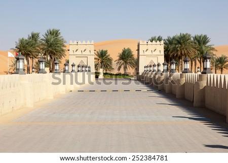 ABU DHABI - DEC 22: Gate to the Qasr Al Sarab Desert Resort by Anantara in Abu Dhabi. December 22, 2014 in Liwa Desert, United Arab Emirates - stock photo