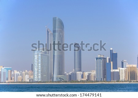 ABU DHABI - MARCH 31, 2013: Abu Dhabi skyline and waterfront taken on March 31, 2013 in Abu Dhabi, United Arab Emirates. - stock photo