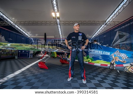 Abu Dhabi - MARCH 12: Petr Kopfstrein from Spielberg Team posing next to plane in Hangar  in Al Bateen Airport on Red Bull Air Race World Championship 2016  on March 12, 2016 in Abu Dhabi, UAE