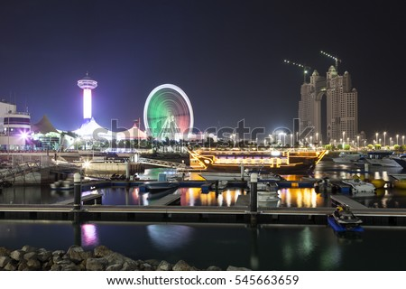 Abu Dhabi Marina illuminated at night. United Arab Emirates, Middle East