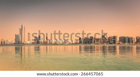 Abu Dhabi Skyline during golden hour at sunset - stock photo