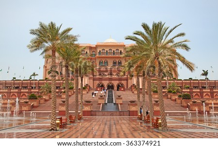 ABU DHABI, UAE - APRIL 27: Gate to the Emirates Palace hotel on April 27, 2014, UAE. Seven stars Emirates Palace is the second most expensive hotel ever built for about 6 billion USD. - stock photo