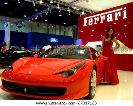 ABU DHABI, UAE - DECEMBER 10:Ferrari 458 Italia on display during Abu Dhabi Int'l Motor Show 2010 at Abu Dhabi Int'l Exhibition Centre December 10, 2010 in Abu Dhabi,United Arab Emirates. - stock photo