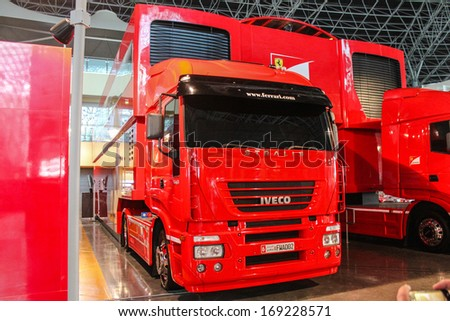 ABU DHABI, UAE - DECEMBER 24:Ferrari Truck, on display ferrari world at Exhibition Centre December 24, 2013 in Abu Dhabi,United Arab Emirates.  - stock photo