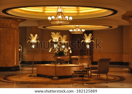 ABU DHABI, UAE - FEB 15: Interior of Emirates Palace Hotel in Abu Dhabi, UAE, as seen on Feb 15, 2014. It is a seven star luxury hotel and has its own marina and helipad. - stock photo