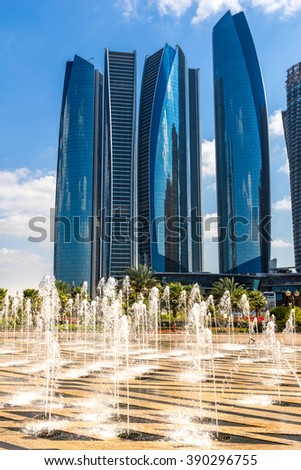 ABU DHABI, UAE - 08 FEBRUARY 2014: Etihad Towers buildings in Abu Dhabi. United Arab Emirates. Five towers complex with 74 floors is the third tallest building in Abu Dhabi. - stock photo