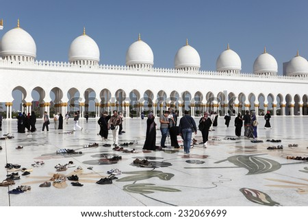 ABU DHABI, UAE - JAN 14: Visitors in the Sheikh Zayed Grand Mosque. January 14, 2012 in Abu Dhabi, United Arab Emirates