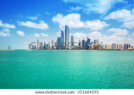 ABU DHABI, UAE - 27 MARCH 2014: Cityscape of Abu Dhabi at Persian Gulf, UAE. Abu Dhabi is the capital and the second most populous city in the United Arab Emirates with around 1 million people. - stock photo