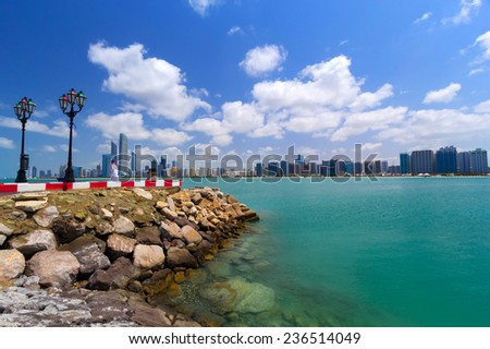ABU DHABI, UAE - MARCH 27: Cityscape of Abu Dhabi on March 27, 2014, UAE. Abu Dhabi is the capital and the second most populous city in the United Arab Emirates with around 1 million people. - stock photo