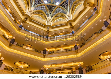 ABU DHABI, UAE - MARCH 16: Dome decoration in Emirates Palace hotel on March 16, 2012. This is a luxurious and the most expensive 7 star hotel designed by renowned architect, John Elliott RIBA. - stock photo