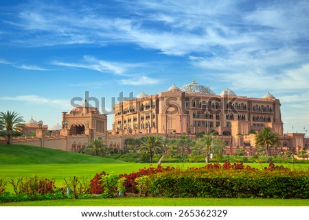 ABU DHABI, UAE - MARCH 29: Emirates Palace and gardens in Abu Dhabi on March 29, 2014, UAE. Five stars Emirates Palace is the second most expensive hotel ever built for about 6 billion USD. - stock photo