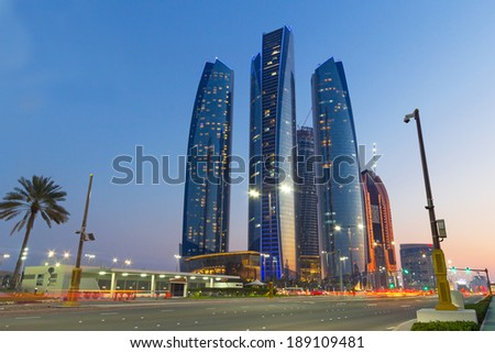ABU DHABI, UAE - MARCH 26: Etihad Towers buildings in Abu Dhabi on March 26, 2014, UAE. Five towers complex with 74 floors is the third tallest building in Abu Dhabi. - stock photo