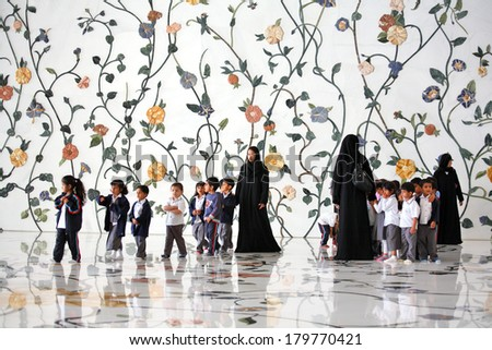 ABU DHABI, UAE - MARCH 4, 2010: Group of children visiting Sheikh Zayed Mosque - stock photo
