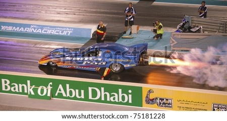 ABU DHABI, UAE - MARCH 4: Hot Rod Fuller set a new UAE record at the Yas Drag Racing Festival hitting a terminal speed of 357.43 km/h on March 4, 2011 in Abu Dhabi, UAE. - stock photo