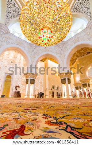 ABU DHABI, UAE - 26 MARCH 2014: Interior of Sheikh Zayed Grand Mosque in Abu Dhabi, United Arab Emirates. Mosque has many unique elements like 12 tons chandelier covered by gold and Swarovski crystals - stock photo