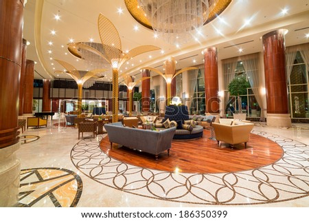 ABU DHABI, UAE - MARCH 26: Lobby and hall of Khalidiya Palace by Rotana on March 26, 2014, UAE. Rotana Hotel Management Corporation has 85 properties in 26 cities around Middle East and Africa. - stock photo