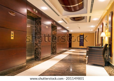 ABU DHABI, UAE - 31 MARCH 2014: Lobby and hall of The Grand Midwest Tower Hotel in Dubai, UAE. The Grand Midwest Group owns 4 hotels in Dubai with over 700 rooms.  - stock photo