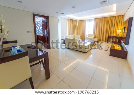 ABU DHABI, UAE - MARCH 30: Luxury living room of The Grand Midwest Tower Hotel in Dubai on 30 March 2014, UAE. The Grand Midwest Group owns 4 hotels in Dubai with over 700 rooms. - stock photo