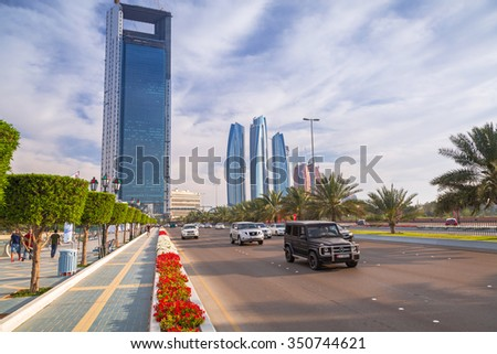 ABU DHABI, UAE - MARCH 29, 2014: Modern city architecture of Abu Dhabi, UAE. Abu Dhabi is the capital and the second most populous city in the United Arab Emirates with around 1 million people. - stock photo