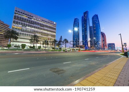 ABU DHABI, UAE - MARCH 28: Streets of Abu Dhabi at night with Etihad Towers buildings on March 28, 2014, UAE.  Abu Dhabi is the capital and the second most populous city of the United Arab Emirates. - stock photo