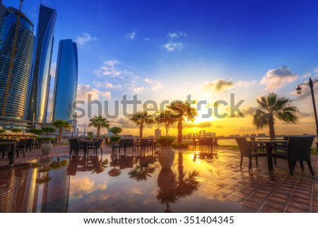 ABU DHABI, UAE - MARCH 27, 2014: Sunrise at Etihad Towers in Abu Dhabi, UAE. Five towers complex with 74 floors is the third tallest building in Abu Dhabi. - stock photo